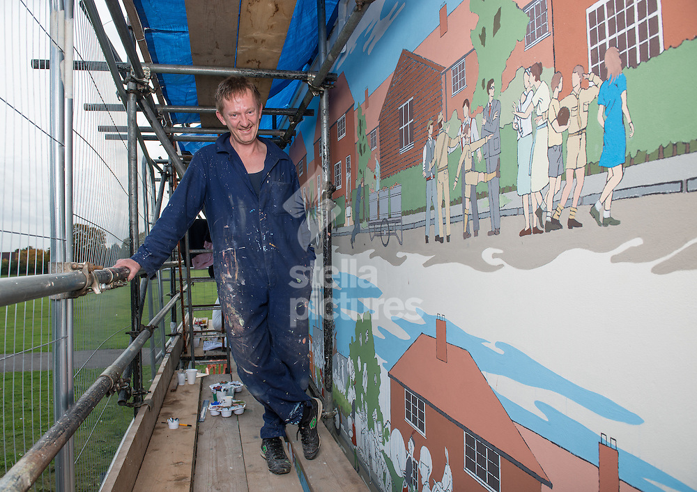 Scottish artist Chad McCail pictured with his mural 'This Used To Be Fields' at Valence House Museum, Dagenham.<br /> Picture by Daniel Hambury/Stella Pictures Ltd +44 7813 022858<br /> 16/10/2014