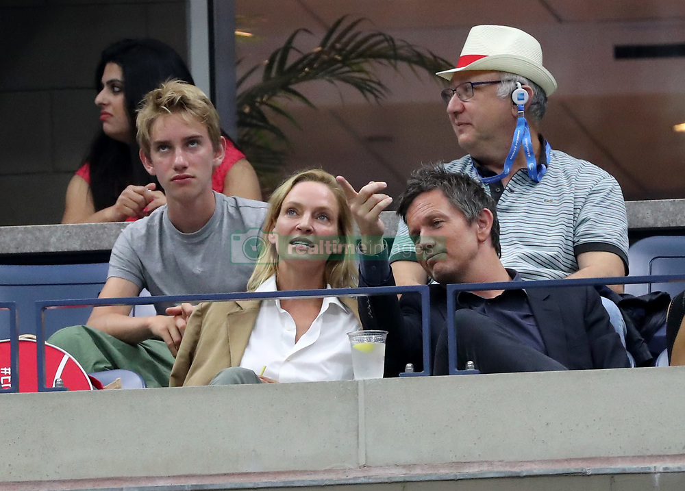 Uma Thurman and her son, Levon were at the U.S. Open tonight watching Rafael Nadal vs. Andrey Rublev. Thurman, 47 was seen with a mystery man whom she sat next to during part of the match. ***NO NEW YORK DAILY NEWS, NO NEW YORK TIMES, NO NEWSDAY***. 06 Sep 2017 Pictured: Uma Thurman, Levon Thurman-Hawke. Photo credit: Charles Wenzelberg/New York Post / MEGA TheMegaAgency.com +1 888 505 6342
