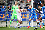 Peterborough Utd forward Matthew Godden (9) is held by Coventry City midfielder Liam Kelly (6) at this corner during the EFL Sky Bet League 1 match between Peterborough United and Coventry City at London Road, Peterborough, England on 16 March 2019.