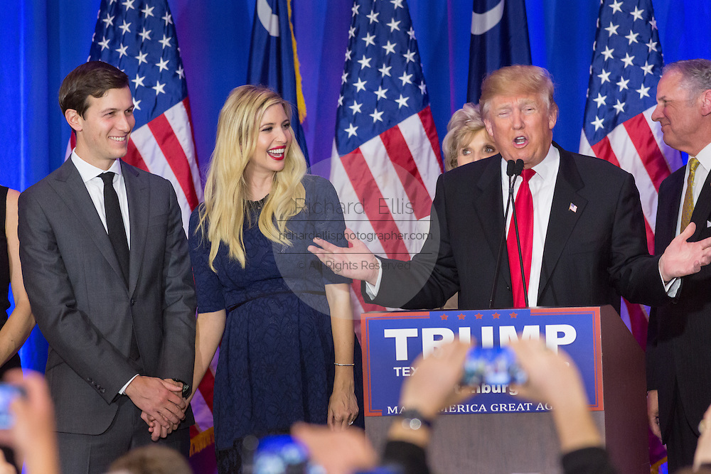 Billionaire and GOP presidential candidate Donald Trump addresses supporters as daughter Ivanka and her husband Jared Kushner join in to celebrate victory in the South Carolina Republican primary February 20, 2016 in Spartanburg, South Carolina, USA .