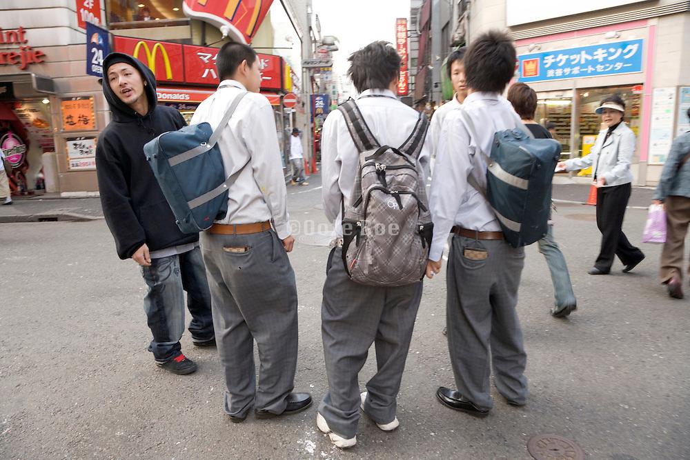 teenaged boys hanging around in the street Shibuya Tokyo