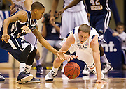 BYU guard Brock Zylstra (13) recovers a loose ball during the first half of the NCAA basketball game between the BYU Cougars and the Northern Arizona Lumberjacks at Marriott Arena, Thursday, Dec. 27, 2012.