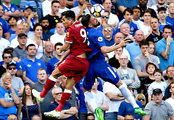 Liverpool's Roberto Firmino (left) and Chelsea's Olivier Giroud battle for the ball during the Premier League match at Stamford Bridge, London.