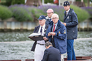 Henley Royal Regatta, Henley on Thames, Oxfordshire, 3-7 July 2013.  Thursday  09:46:21   04/07/2013  [Mandatory Credit/Intersport Images]<br /> <br /> Rowing, Henley Reach, Henley Royal Regatta.<br /> <br /> Timekeepers in action on the back of the umpires launch