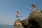 A group of kids enjoy jumping into the water on a sunny summer day in Mallorca (Spain)<br /> <br /> Un grupo de niños disfrutan saltando al agua un soleado día de verano en Mallorca (Islas Baleares, España)