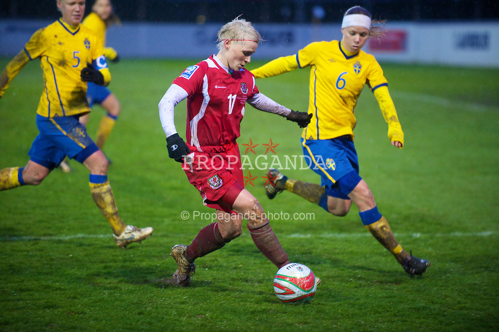 BROUGHTON, ENGLAND - Wednesday, March 31, 2010: Wales' Jessica Fishlock in action against Sweden's Sara Thunebro during the FIFA Women's World Cup 2011 Qualifying Group 8 match at the Airfeld. (Pic by David Rawcliffe/Propaganda)