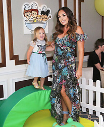 """Tamara Ecclestone releases a photo on Instagram with the following caption: """"Spending quality time with my beautiful daughter at the launch event for my latest venture, @fifiandfriendsofficial. I know a lot of you are keen to know more about our babycare range to launch this August. There's so much more to come so stay tuned! #MyFifi"""". Photo Credit: Instagram *** No USA Distribution *** For Editorial Use Only *** Not to be Published in Books or Photo Books ***  Please note: Fees charged by the agency are for the agency's services only, and do not, nor are they intended to, convey to the user any ownership of Copyright or License in the material. The agency does not claim any ownership including but not limited to Copyright or License in the attached material. By publishing this material you expressly agree to indemnify and to hold the agency and its directors, shareholders and employees harmless from any loss, claims, damages, demands, expenses (including legal fees), or any causes of action or allegation against the agency arising out of or connected in any way with publication of the material."""