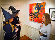 Manhasset, New York, U.S. October 14, 2016. Two Board Members dress as witches at Halloween themed Reception for The Art Guild exhibition is held at Elderfields Preserve.