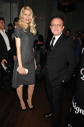 CLAUDIA SCHIFFER and wine maker RICHARD GEOFFROY at a party to launch the Dom Perignon OEotheque 1995 held at The Landau, Portland Place, London W1 on 26th February 2008.<br />