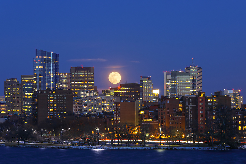 On 12 March 2017, I ventured out into Boston to photograph the full moon rising across its iconic skyline. It was a bitter cold night in the single digits. Usually there are plenty of bikers, walkers and runners but not on this frigid night. I also noted no other photographers which made me wonder a little bit about myself. In this photograph, I selected a tighter and more intimate composition to capture the moon with the newly constructed Millennium Tower, one of Boston's new landmarks. <br /> <br /> Boston full moon photos are available as museum quality photo prints, canvas prints, acrylic prints or metal prints. Fine art prints may be framed and matted to the individual liking and decorating needs:<br /> <br /> http://juergen-roth.pixels.com/featured/boston-moonrise-juergen-roth.html<br /> <br /> All Boston skyline photos are available for photography image licensing at www.RothGalleries.com. Please contact me direct with any questions or request.<br /> <br /> Good light and happy photo making!<br /> <br /> My best,<br /> <br /> Juergen<br /> Prints: http://www.rothgalleries.com<br /> Photo Blog: http://whereintheworldisjuergen.blogspot.com<br /> Instagram: https://www.instagram.com/rothgalleries<br /> Twitter: https://twitter.com/naturefineart<br /> Facebook: https://www.facebook.com/naturefineart