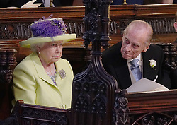 Queen Elizabeth II and Prince Phillip during the wedding service for Prince Harry and Meghan Markle at St George's Chapel, Windsor Castle.