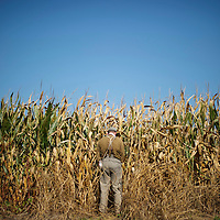 In a break during General A.P. Hill's 18 mile march from Harper's Ferry, WV to Sharpsburg, MD, a Confederate soldier from the 14th Tennessee infantry relieves himself in a cornfield, during the 150th Antietam Civil War Reenactment.