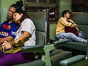 14 JANUARY 2016 - BANGKOK, THAILAND:  People sleep in an unairconditioned third class train car on the State Railways of Thailand Eastern Line, which goes from Bangkok to the Cambodian border.          PHOTO BY JACK KURTZ