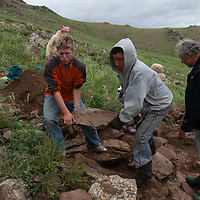 MONGOLIA. Smithsonian Museum archaeology team led by Dr. Bruno Frohlich unearths 2700+ year-old, khirigsur burial mounds at site above Delger River, near Muren. <br /> <br /> #MS0702_060708_0203.NEF