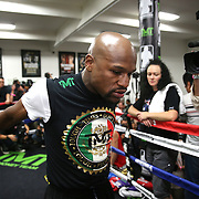 LAS VEGAS, NV - APRIL 14: WBC/WBA welterweight champion Floyd Mayweather Jr. stretches before he works out at the Mayweather Boxing Club on April 14, 2015 in Las Vegas, Nevada. Mayweather will face WBO welterweight champion Manny Pacquiao in a unification bout on May 2, 2015 in Las Vegas.  (Photo by Alex Menendez/Getty Images) *** Local Caption *** Floyd Mayweather Jr.