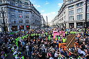 On its 3rd day of the protest campaign, environmental activist group Extinction Rebellion put at halt the entire Regent Street and Oxford Circus by blocking the main junction on Wednesday, Aug 25, 2021. XR launched a two-week protest campaign in London on Monday to demand that the government take greater action to address climate change. (VX Photo/ Vudi Xhymshiti)