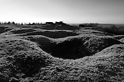 Verdun WW1 Battlefield site, Verdun-sur-Meuse, France. March 2014<br /> Seen here :<br /> The shell cratered remains of Fort Douaumont on the Verdun Battlefield.<br /> Fort Douaumont (French Fort de Douaumont) was the largest and highest fort on the ring of 19 large defensive forts protecting the city of Verdun, France since the 1890s. However, by 1915 the French General Staff had concluded that even the best-protected forts of Verdun could not resist bombardments from the German 420 mm (16 in) Gamma guns. These newly deployed giant howitzers had easily taken several large Belgian forts out of action in August 1914. As a result, Fort Douaumont and other Verdun forts, being judged ineffective, had been partly disarmed and left virtually undefended since 1915. Consequently, on 25 February 1916, Fort Douaumont was entered and occupied without a fight by a small German raiding party comprising only 19 officers and 79 men. The easy fall of Fort Douaumont, only three days after the beginning of the Battle of Verdun, produced a deep shock in the French Army's command structure. It set the stage for the rest of a battle which lasted nine months, at enormous human costs. Douaumont was finally recaptured by three infantry divisions of the French Second Army, during the First Offensive Battle of Verdun on 24 October 1916. This event brought closure to the Battle of Verdun in 1916.[1]<br /> <br /> The Battle of Verdun lasted 9 months, 3 weeks and 6 days between 21 February and 20 december 1916. It was the longest and one of the most costly battles in human history;  recent estimates increase the number of casualties to 976,000.<br /> <br /> Caption information below from wikipedia:<br /> The Battle of Verdun (Bataille de Verdun0, was fought from 21 February – 18 December 1916 during the First World War on the Western Front between the German and French armies, on hills north of Verdun-sur-Meuse in north-eastern France. The German Fifth Army attacked the defences of the Région F