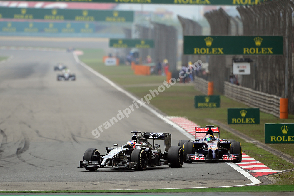 Jenson Button (McLaren-Mercedes) leads Jean-Eric Vergne (Toro Rosso-Renault) during the 2014 Chinese Grand Prix in Shanghai. Photo: Grand Prix Photo
