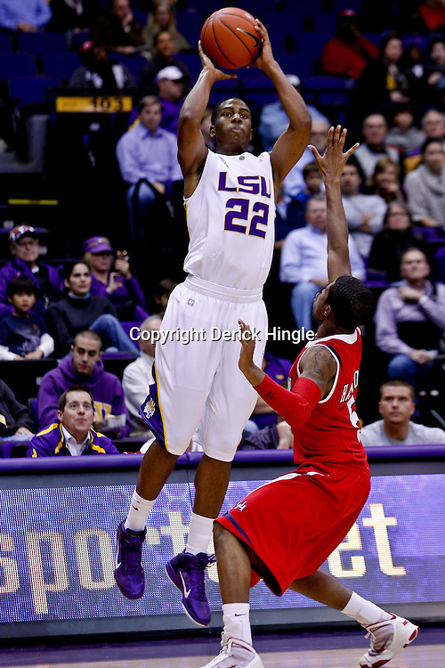 November 30, 2010; Baton Rouge, LA, USA;  LSU Tigers guard Ralston Turner (22) shoots over Houston Cougars guard Nick Haywood (5) during the first half at the Pete Maravich Assembly Center.  Mandatory Credit: Derick E. Hingle