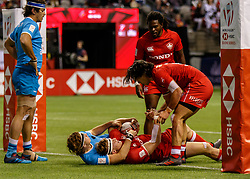 March 10, 2018 - Vancouver, British Columbia, U.S. - VANCOUVER, BC - MARCH 10: John Moonlight (#4) of Canada is congratulated by Nathan Hirayama (#9) after his score during Game # 23- Canada vs Uruguay Pool A match at the Canada Sevens held March 10-11, 2018 in BC Place Stadium in Vancouver, BC. (Photo by Allan Hamilton/Icon Sportswire) (Credit Image: © Allan Hamilton/Icon SMI via ZUMA Press)