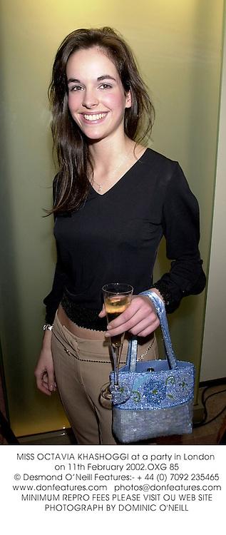 MISS OCTAVIA KHASHOGGI at a party in London on 11th February 2002.OXG 85