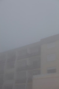Buildings in La Mongie, ski resort, in a thick fog.