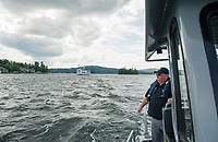 Dept of Safety Marine Patrol Captain Tim Dunleavy patrols around Governors Island on Lake Winnipesaukee Thursday afternoon.  (Karen Bobotas/for the Laconia Daily Sun)