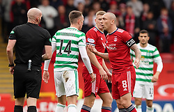 Aberdeen's Scott Brown (right) speaks with Celtic's David Turnbull during the cinch Premiership match at Pittodrie Stadium, Aberdeen. Picture date: Sunday October 3, 2021.