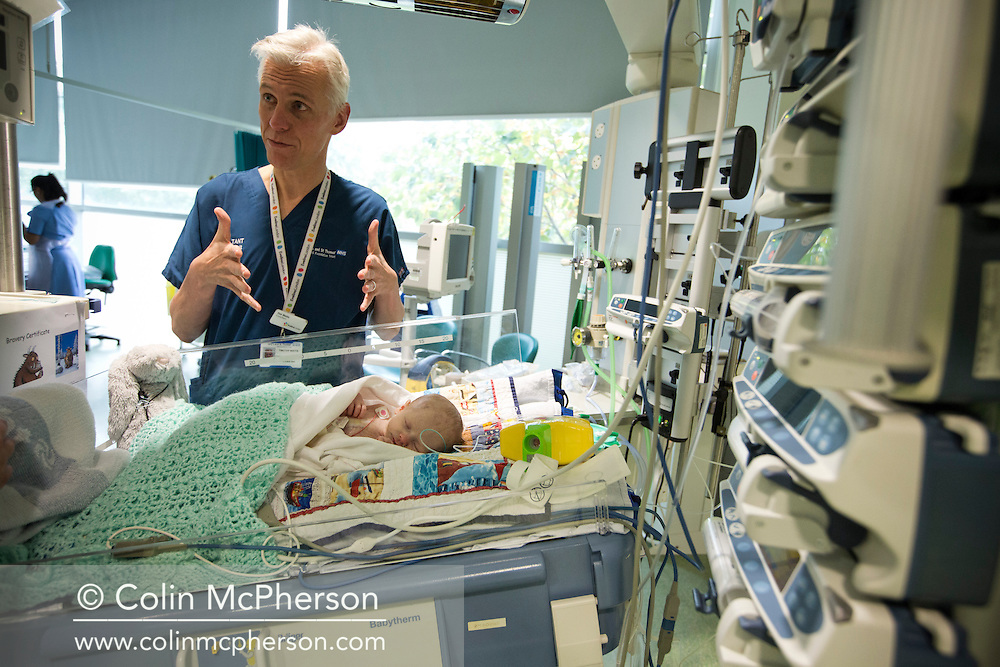 Kathryn Jones discusses the condition of her three-and-a-half-week-old Finn with consultant Dr Tim Watts at the Evelina paediatric intensive care unit at St. Thomas Hospital in central London. The son of Philip and Kathryn Jones from Canterbury, Kent, Finn was born with a pre-diagnosed condition which required a life-saving, five-hour heart 'switch' operation to be carried out within the first two weeks of his life. The operation, which took place when Finn was 10 days old was successful, however, due to other near fatal complications the his recovery during the subsequent six weeks was slow and difficult.