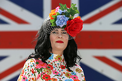 Helen Cass poses for photographs on day three of Royal Ascot at Ascot Racecourse.