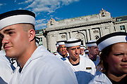 """Midshipman search for their family and friends shortly after taking their oath of office at the U.S. Naval Academy in Annapolis, MD. Approximately 1,230 young men and women arrived at the U.S. Naval Academy's Alumni Hall, Thursday, July 1, for Induction Day to begin their new lives as """"plebes"""" or midshipmen fourth class (freshmen). """"I-Day"""" culminates when the members of the Class of 2014 take the oath of office at a ceremony at 6 p.m. in Tecumseh Court, the historic courtyard of the Bancroft Hall dormitory. Over 17,400 young men and women applied to be members of the Naval Academy Class of 2014 - a record for USNA."""