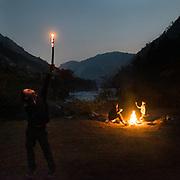 A night, a family around a firecamp.