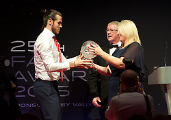 CARDIFF, WALES - Monday, October 5, 2015: Wales' Gareth Bale receive the Player of the Year Award from FAW President David Griffiths and Vauxhall's Cheryl Stibbs during the FAW Awards Dinner at Cardiff City Hall (Pic by Ian Cook/Propaganda)
