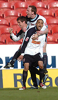 Photo. Leigh Quinnell.  Swindon Town v Walsall Coca Cola league one. 09/04/2005. Walsalls Mark Wright celebrates his last minute goal for Walsall with Darren Wrack and Matt Fryatt.