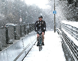 Heavy Snowfall in West Lothian, Wednesday, 4th April 2018<br /> <br /> More heavy snow fell in West Lothian this afternoon causing traffic problems for drivers on the M8 Edinburgh to Glasgow motorway.<br /> <br /> A brave cyclist battles through the snow<br /> <br /> Alex Todd | EEm
