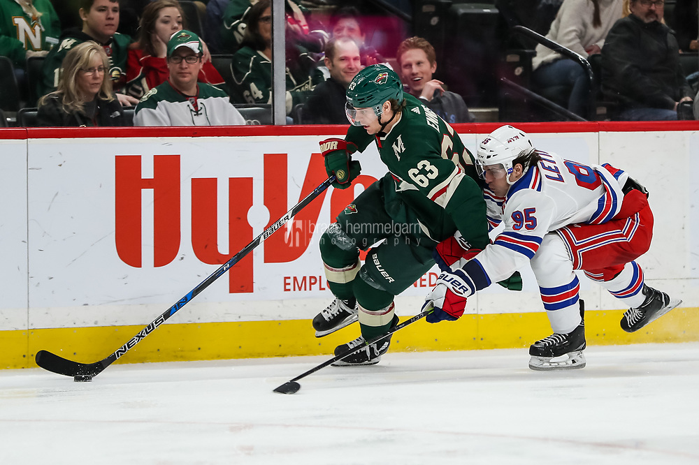 Feb 13, 2018; Saint Paul, MN, USA; Minnesota Wild forward Tyler Ennis (63) protects the puck from New York Rangers forward Vinni Lettieri (95) during the second period  at Xcel Energy Center. Mandatory Credit: Brace Hemmelgarn-USA TODAY Sports