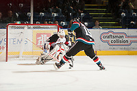 KELOWNA, CANADA - OCTOBER 18: Colton Sissons #15 of the Kelowna Rockets takes a penalty shot on Marc Engel #30 of the Prince George Cougars as the Prince George Cougars visit the Kelowna Rockets on October 18, 2012 at Prospera Place in Kelowna, British Columbia, Canada (Photo by Marissa Baecker/Shoot the Breeze) *** Local Caption ***