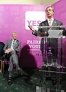 licensed to London News Pictures. LONDON UK. 27/04/11. Alan Johnson (L) listens to Nigel Farage (R). A News conference held today (27 April 2011) in Church House, London. The conference was introduced by Katie Ghose with Lib Dem President Tim Farron, Green Party Leader Caroline Lucas, UKIP leader Nigel Farage and  Labour's  Alan Johnson, supporting a Yes for the Alternative Vote. Photo credit should read Stephen Simpson/LNP