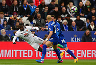 M'bate Niang of Watford  (l) battles with Yohan Benalouane and Christian Fuchs of Leicester city.  Premier league match, Leicester City v Watford at the King Power Stadium in Leicester, Leicestershire on Saturday 6th May 2017.<br /> pic by Bradley Collyer, Andrew Orchard sports photography.