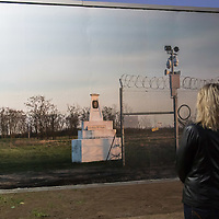Visitor watches a billboard showing the end of the border fence between Hungary and Serbia on display at the Arc Billboard social issues exhibition in Budapest, Hungary on Sept. 24, 2018. ATTILA VOLGYI