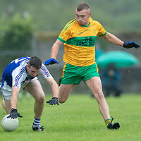 St. Senan's Kilkee's Barry Harte falls after a challenge from O'Curry's Nigel Murray