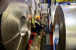 File photo dated 15/02/17 of a worker inspecting rolls of steel. Output in Britain's manufacturing industry eased back from a three-year high, but beat expectations in May thanks to robust growth in new orders.