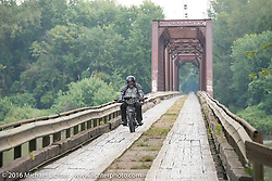 Richard Asprey of Texas riding his 1915 Norton over the treacherous to motorcycles, wooden Wabash Cannonball Bridge in St. Francisville, Illinois during the Motorcycle Cannonball Race of the Century. Day-4 ride from Bloomington, IN to Cape Girardeau, MO. USA. Wednesday September 14, 2016. Photography ©2016 Michael Lichter.