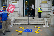 Steve Bray stands with four rubber yellow hammers on the pavement outside the Cabinet Office in London, United Kingdom on 12th September 2019. Last night the government published details of Operation Yellowhammer which is the codename used by the UK Treasury for cross-government civil contingency planning fin the event of a no-deal Brexit after MPs voted to force its release.