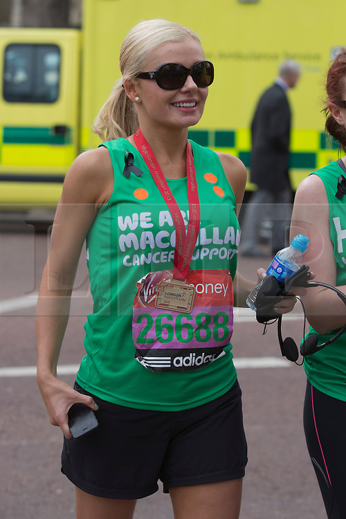 © Licensed to London News Pictures. 21/04/2013. London, England. Picture: singer Katherine Jenkins after finishing the race in the Mall. Celebrity Runners and Fun Runners finish the Virgin London Marathon 2013 race in the Mall, London. Many wore black ribbons to pay their respect for those who died or were injured in the Boston Marathon. Photo credit: Bettina Strenske/LNP