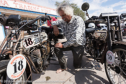 Thor Loser Doug Feinsod of CA does some bike maintenance at the Mesa Trading Post in Arizona after riding all morning in the rain on his 1913 Thor during the Motorcycle Cannonball Race of the Century. Stage-11 ride from Durango, CO to Page, AZ. USA. Wednesday September 21, 2016. Photography ©2016 Michael Lichter.