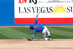 March 18, 2018 - Las Vegas, NV, U.S. - LAS VEGAS, NV - MARCH 18: Addison Russell (27) of the Cubs struggles with a ground ball that would be ruled a hit during a game between the Chicago Cubs and Cleveland Indians as part of Big League Weekend on March 18, 2018 at Cashman Field in Las Vegas, Nevada. (Photo by Jeff Speer/Icon Sportswire) (Credit Image: © Jeff Speer/Icon SMI via ZUMA Press)