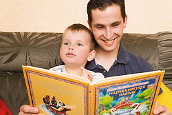 Father reading to his son in Polish,