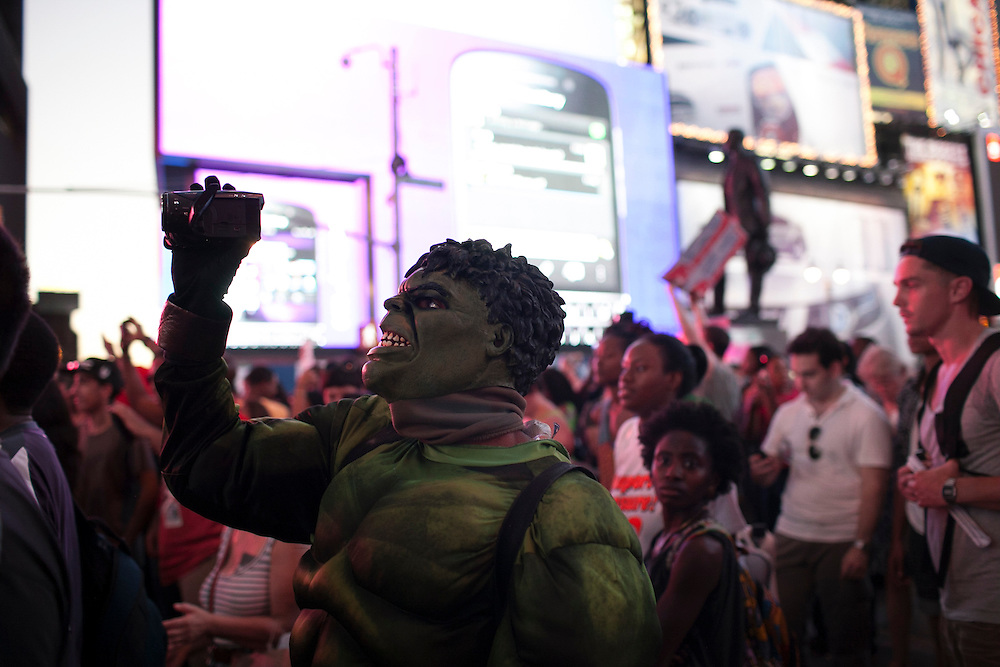 People march to Times Square after a rally in Union Square in reaction to the acquittal of George Zimmerman in the shooting death of Trayvon Martin in New York, NY, on Sunday, July 14, 2013. <br /> <br /> Photograph by Andrew Hinderaker.