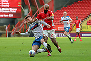 Rochdale defender Ryan Delaney (5) fouling Charlton Athletic midfielder Josh Parker (10) during the EFL Sky Bet League 1 match between Charlton Athletic and Rochdale at The Valley, London, England on 4 May 2019.